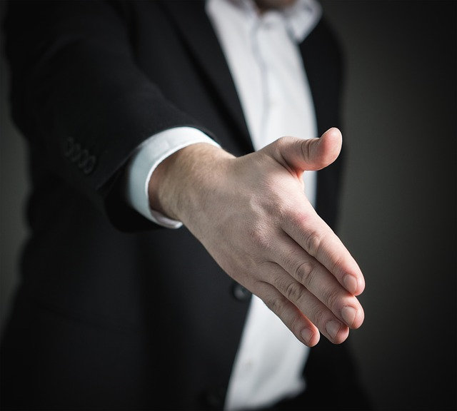 man extending his hand for a hand shake